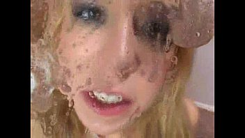 Blonde girl spit cum in camera lens and licks it
