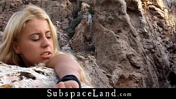 Busty blonde bound by a stone and fucked in doggie