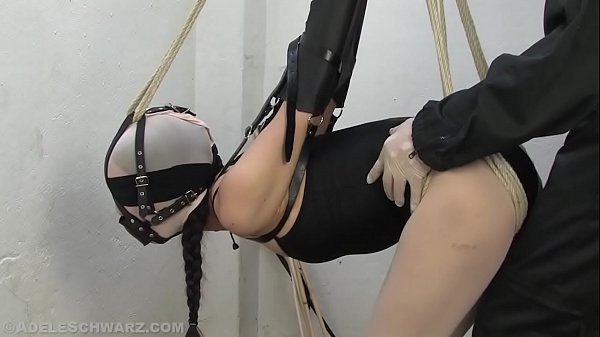 Encased in pantyhose in a armbinder, gagged and to cum