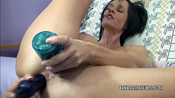 Mature brunette Melissa Swallows plays with two dildos