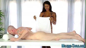 Black masseuse sucks cock