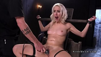Blonde slave hard flogged and gagged with dildo in bdsm