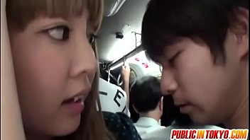 Horny babe gives handjob in a crowded bus
