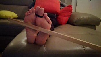 Wife t. feet (bastinado)
