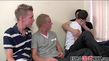 Two twink couples engage in a vigorous foursome on the bed