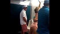 Mature d. pissing in the men's bathroom