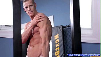 Handsome muscle stud strokes his huge cock