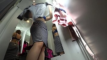 Peeping into the public dressing room, a view from below on a juicy ass and on a sexy girl with long legs, hidden camera.
