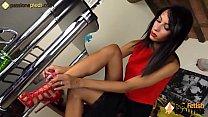 Stunning barefoot brunette spreading her toes