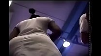 Upskirt fit black mom standing in line