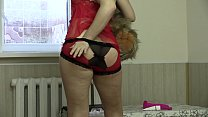 Girl with a nice figure in sexy lingerie undresses and masturbates with a dildo.