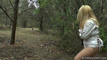 Gagged blonde in strait jacket in public