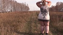 A beautiful mature BBW walks outdoors and shakes a fat butt in a short dress. Fetish and exhibitionism.