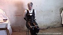Tied Mistress suffers with a plastic b. on her head