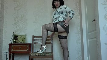 Brunette in stockings masturbates at home and fingers fucks anal and pussy. Foot fetish and juicy ass in a short skirt.