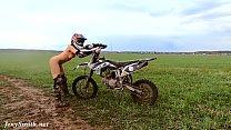 Naked woman riding a Dirt Bike