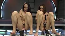 Horny lesbians banging anal machines