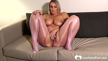 MILF in pantyhose massages her big tatas
