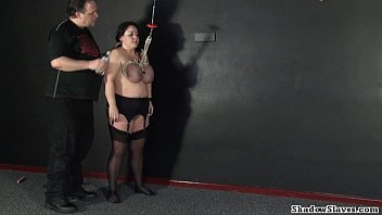 Tit h. of mature roped slavegirl Andrea in extreme big tit whipping