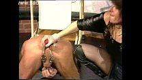 Dirty slave got a dildo up his ass and clamps on his balls while horny mistress hits him with a whip
