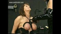 Masked Dominatrix in latex ties the big tits of slave with together with a rope and hits them