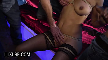 Submissive Claire Castel dominated in a hot gangbang