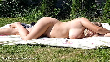A NEIGHBOR SPIES ON A NAKED BIG-BOOBED NUDIST WOMAN