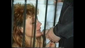 Slave with nice tits sitting in a jail is to suck cock of master and got peed on her body