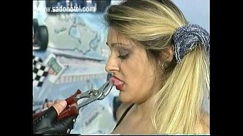Scared milf slave got pulled on her nipples and pussy lips with a piers by masked master