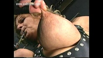 Tied slave with big boobs got her nipples twisted and metal clamps with heavy weight on them