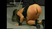 Beautiful slave bends over and got spanked with a stick by master in a dungeon