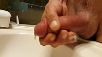 Stroking pumped penis