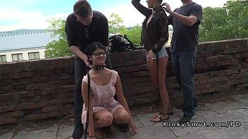 Two hot slaves disgraced in public